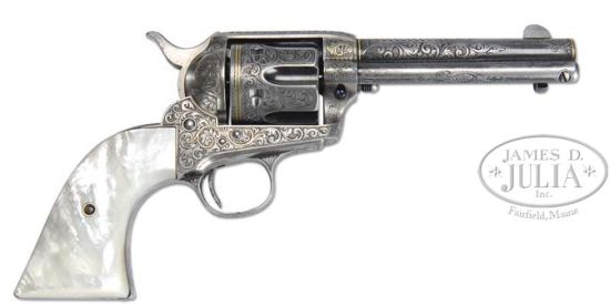 gold inlaid colt handgun